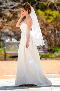 Silk shantung strapless A-line bridal gown with Alcon lace top